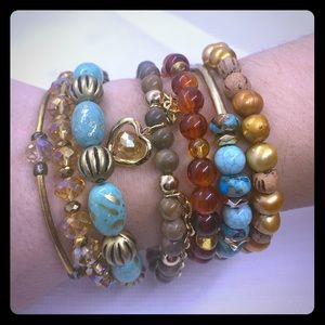 Jewelry - Turquoise and gold stacking bracelets.